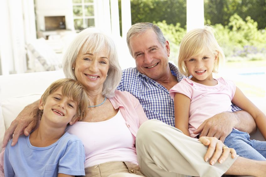 Financial planning for family: grandparents with grandson and granddaughter.