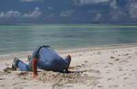 Man with head in sand because he won't deal with the problem of protecting his assets.